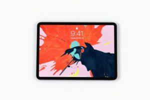 iPadPro2018が横向きで中央にあり、オレンジと水色と黒が飛びちり合わさった壁紙になっている